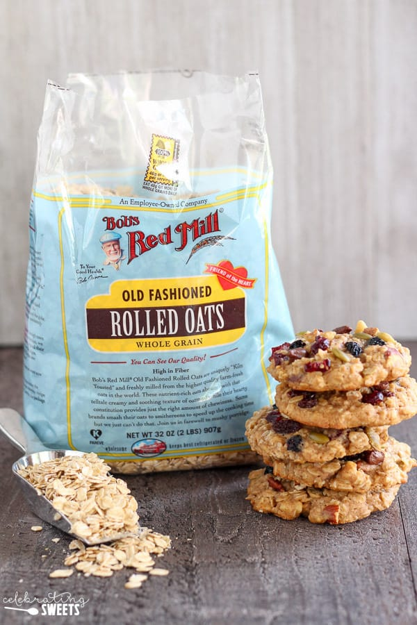 Oatmeal cookies next to a bag of oats.