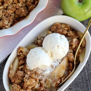 Apple pear crisp topped with vanilla ice cream.