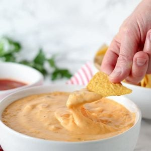 Salsa con Queso with Real Cheese - A creamy and supremely cheesy Queso Dip made with real cheddar cheese. Serve with tortilla chips for dipping OR make homemade Queso Mac and Cheese!