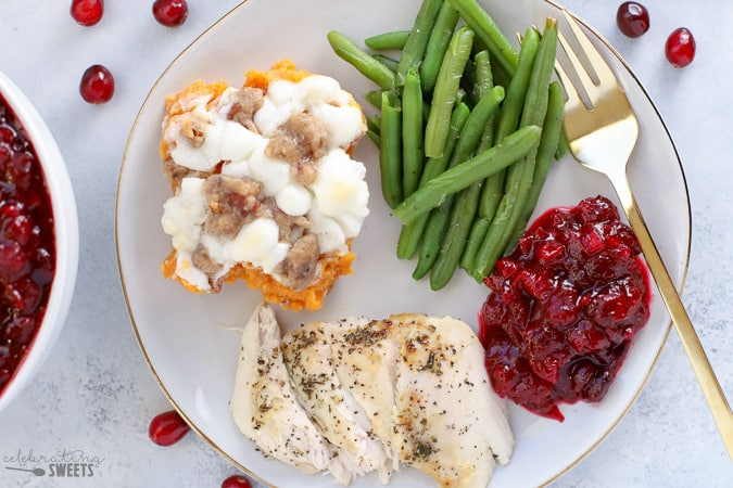 Thanksgiving dinner - turkey, sweet potato casserole, green beans and cranberry sauce.