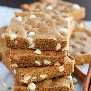 Stack of gingerbread cookie bars filled with white chocolate chips.