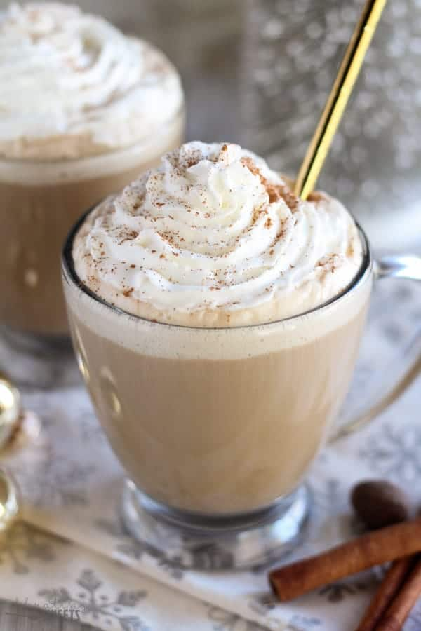 Easy eggnog latte celebrating sweets egg nog latte in a clear mug topped with whipped cream and cinnamon forumfinder Images