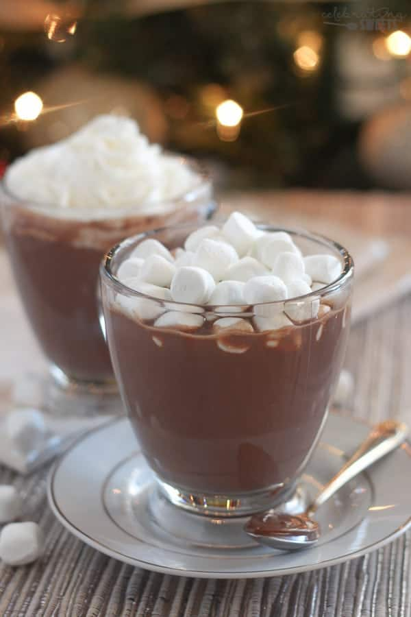 Hot chocolate in a glass topped with marshmallows.