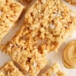 Closeup of a gooey peanut butter rice krispies treat topped with flaky sea salt.