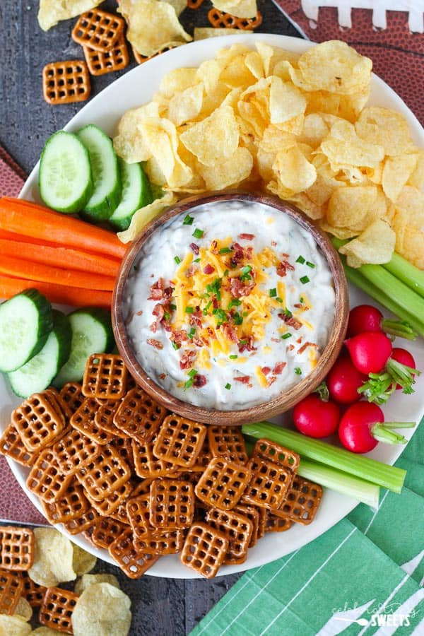 Super Bowl Baked Potato Dip with Chips, Pretzels, and Vegetables.