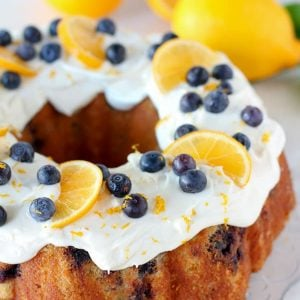 Lemon Blueberry Bundt Cake - A moist and tender lemon buttermilk bundt cake filled with fresh blueberries and topped with cream cheese frosting.