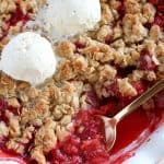 Strawberry Crisp topped with ice cream.