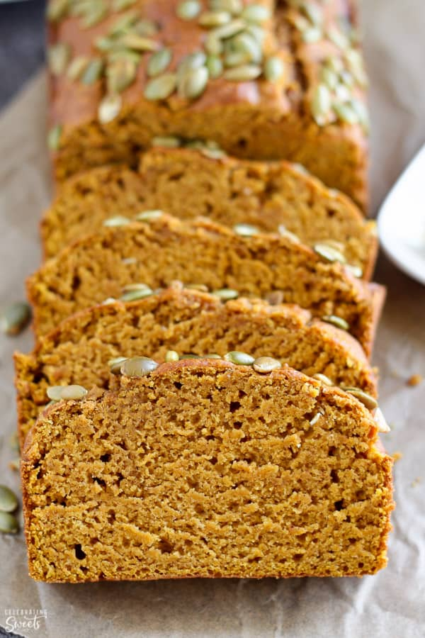 Slices of pumpkin bread on parchment paper.