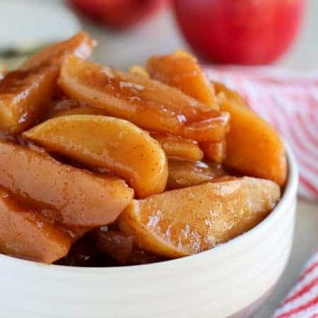 Slow Cooker Cinnamon Apples - An easy recipe for Cinnamon Apples covered in a cider-maple syrup glaze. These sweet and tender apples taste like the inside of an apple pie.