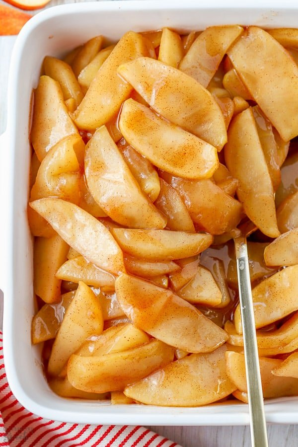 Cinnamon Apples in a white baking dish.