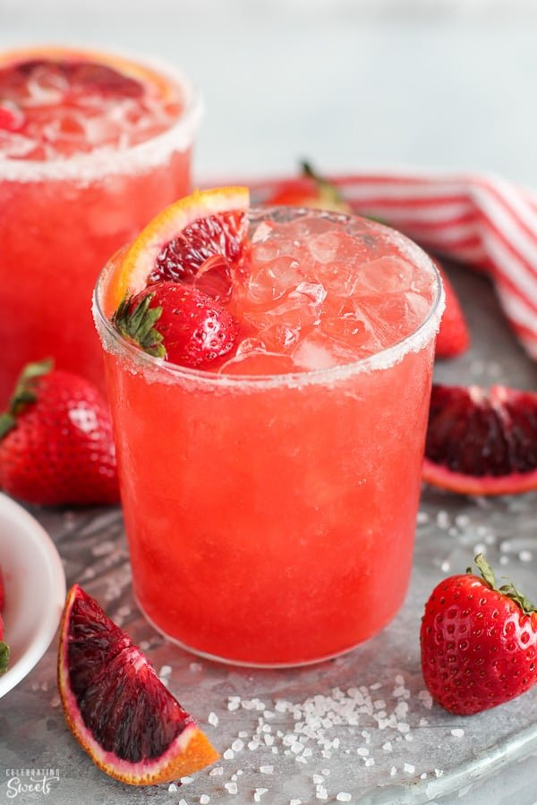 Strawberry margarita in a glass with crushed ice.