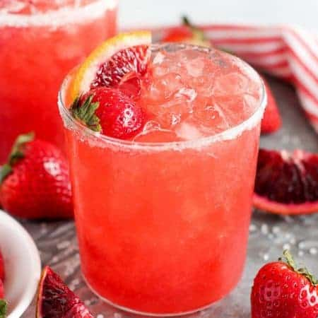 Strawberry margarita in a sugar rimmed glass.