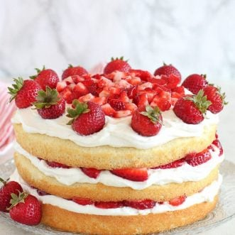 Strawberry Shortcake Cake topped with strawberries.