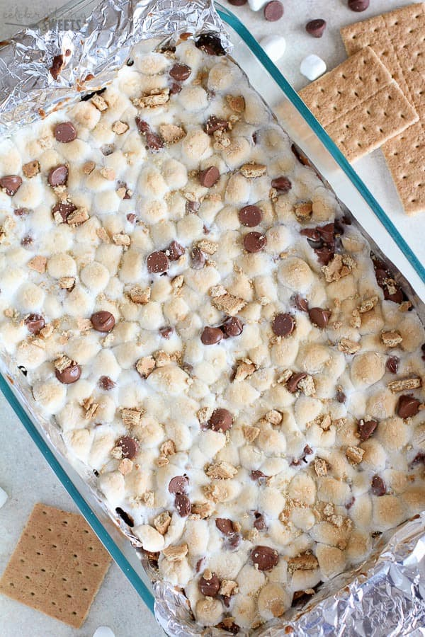 S'mores bars topped with marshmallows in a glass baking dish