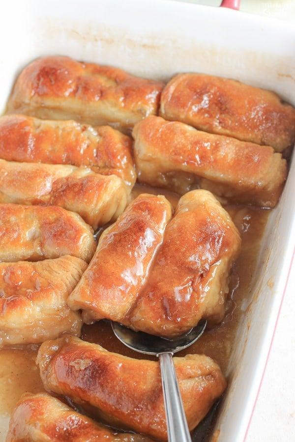 Apple dumplings in a baking dish.