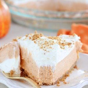 Slice of Cream Cheese Pumpkin Pie on a white plate.
