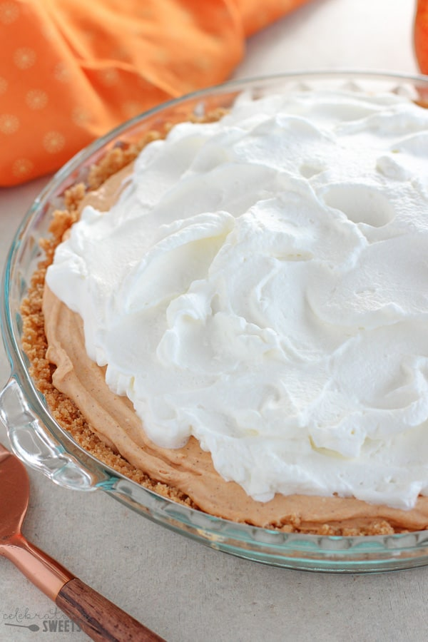 Cream Cheese Pumpkin Pie topped with whipped cream.