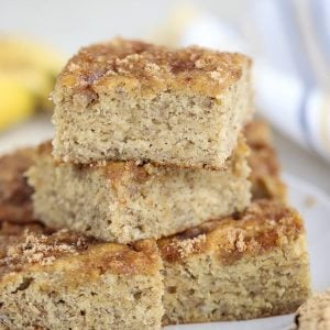 Squares of banana bread stacked on top of each other.