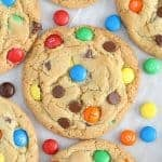 Cookies topped with M&M's and chocolate chips.