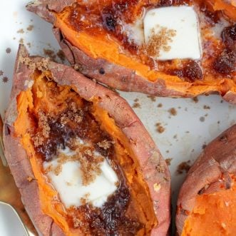Baked Sweet Potatoes topped with butter and brown sugar.