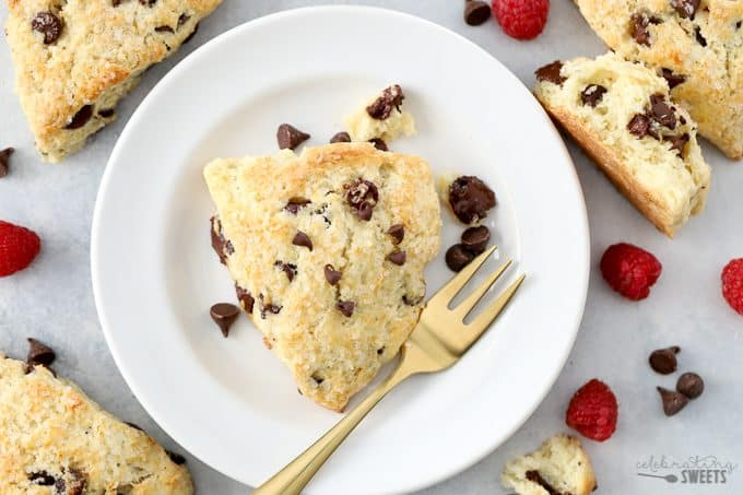 Chocolate Chip Scone on a white plate with a gold fork.