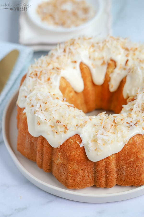 Coconut Bundt Cake topped with cream cheese frosting and toasted coconut.