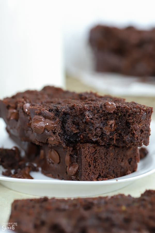 Two slices of Chocolate Zucchini Bread on a white plate.