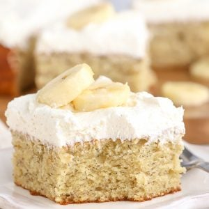 Slice of banana cake on a white plate.