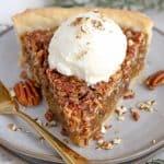 Maple Pecan Pie topped with vanilla ice cream.