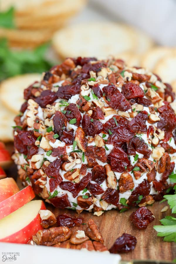 Cheese ball covered in dried cherries, pecans and parsley.