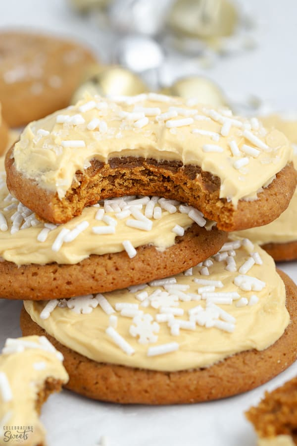Stack of three molasses cookies topped with frosting.