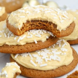 Three molasses cookies topped with frosting.