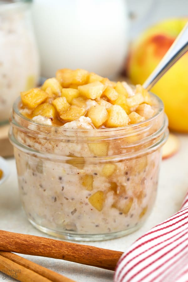 Overnight oats in a jar topped with cinnamon apples.