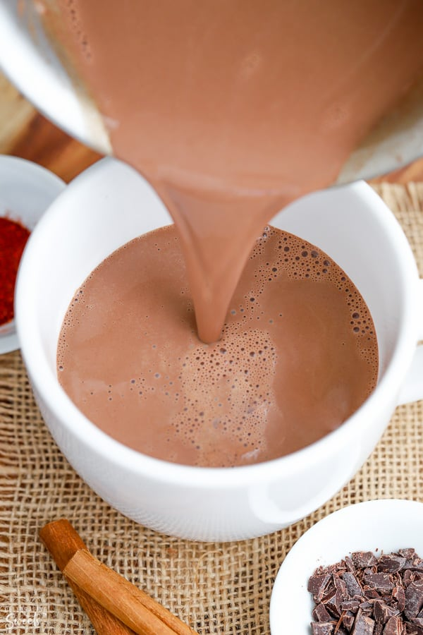 Hot Chocolate being poured into a white mug.