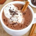 Mexican Hot Chocolate in a white mug topped with whipped cream and chocolate.