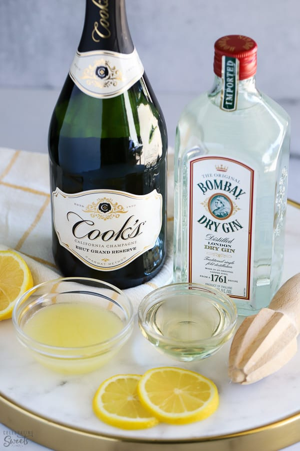 Ingredients to make French 75: champagne, gin, lemon juice, sugar.