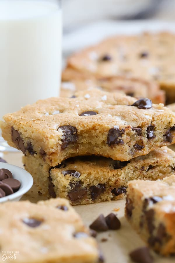 Two chocolate chip cookie bars stacked on top of each other.