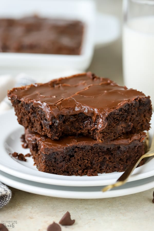 Two brownies on a white plate.