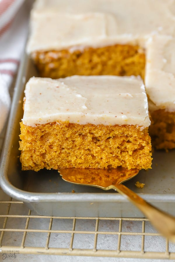 A square slice of pumpkin bar in a grey sheet pan.