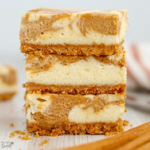 Stack of pumpkin cheesecake bars.