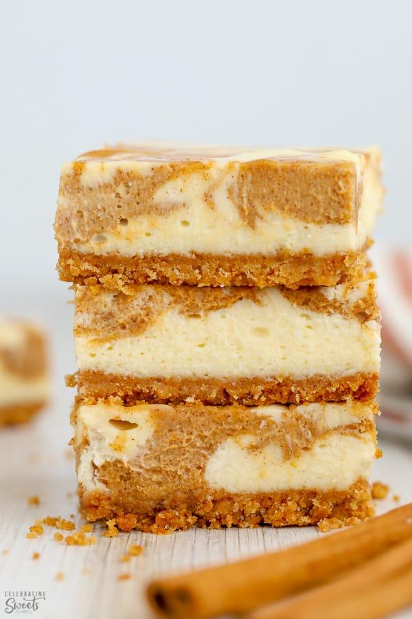 Stack of pumpkin cheesecake bars.