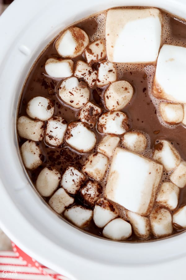 Hot chocolate in a crock pot topped with marshmallows.