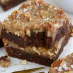 Stack of brownies with pecan topping