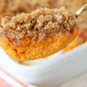 Sweet potato souffle on a large spoon