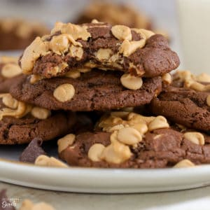 Chocolate peanut butter cookies piled on a plate.