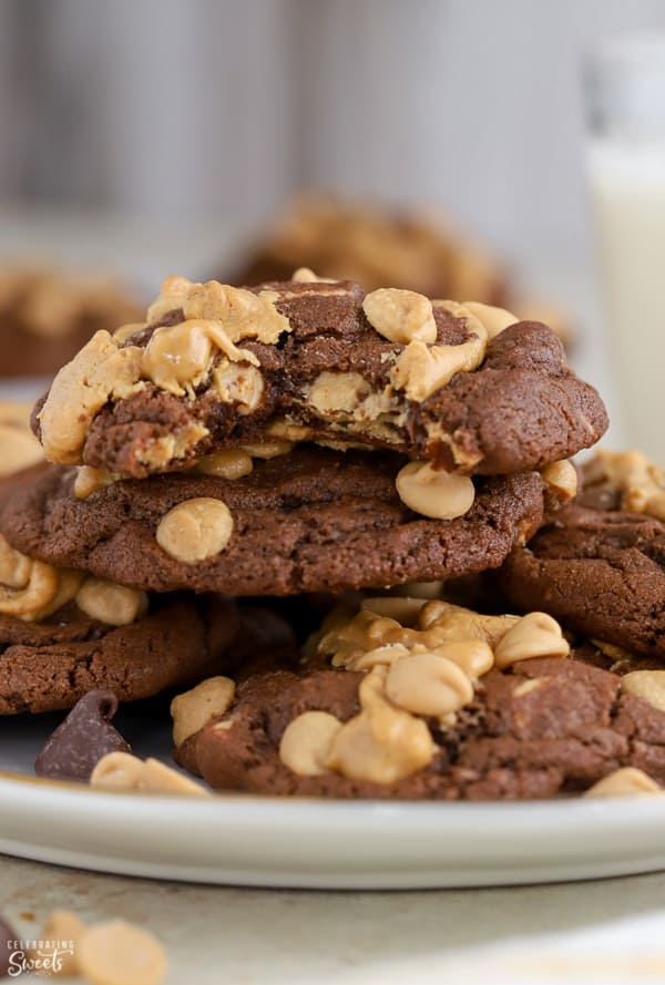 Plate of chocolate cookies topped with peanut butter chips