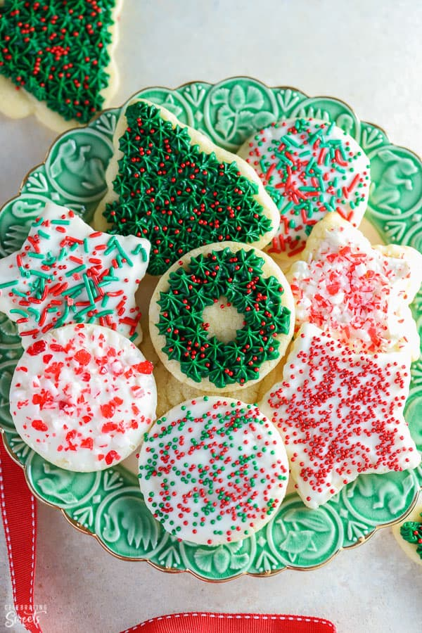 Green plate with christmas cookies on it