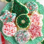Christmas cut out cookies on a green plate