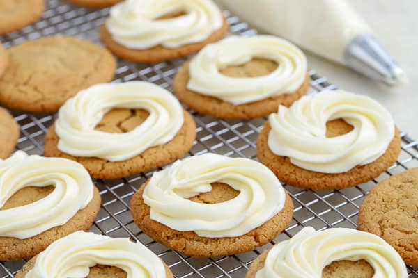 Graham cracker cookies with a swirl of white frosting.
