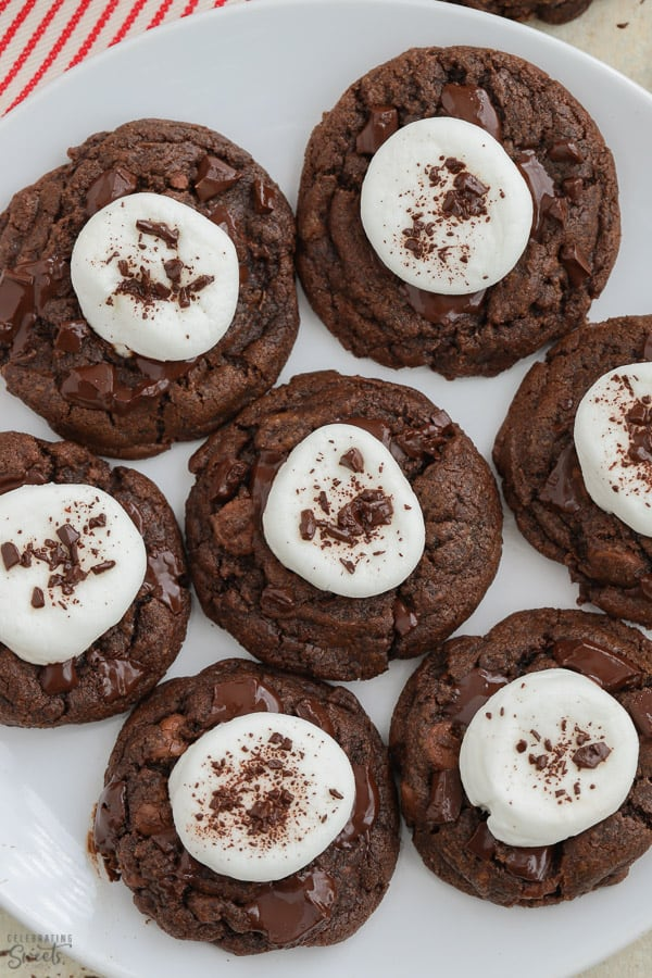 Plate of chocolate cookies topped with marshmallows